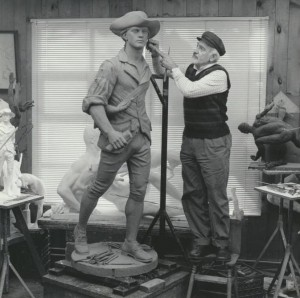 sculptor with statue